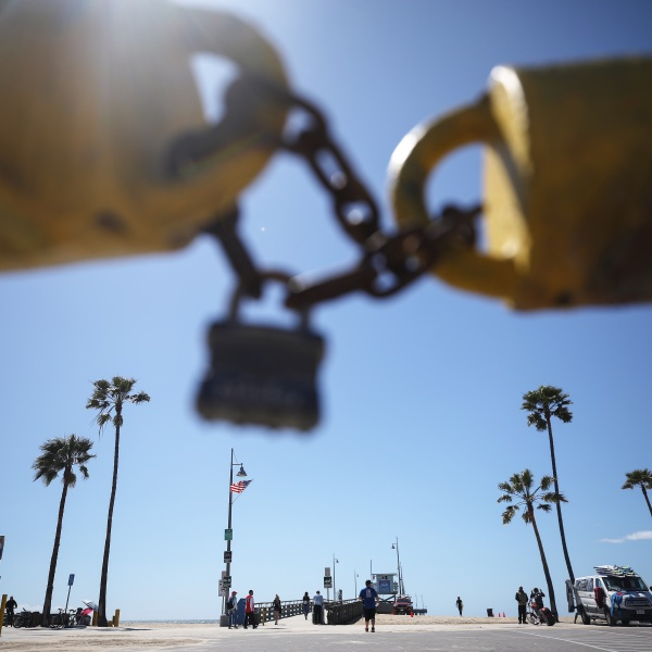 The main Venice Beach parking lot is seen locked on March 23, 2020, in Venice. (Mario Tama/Getty Images)