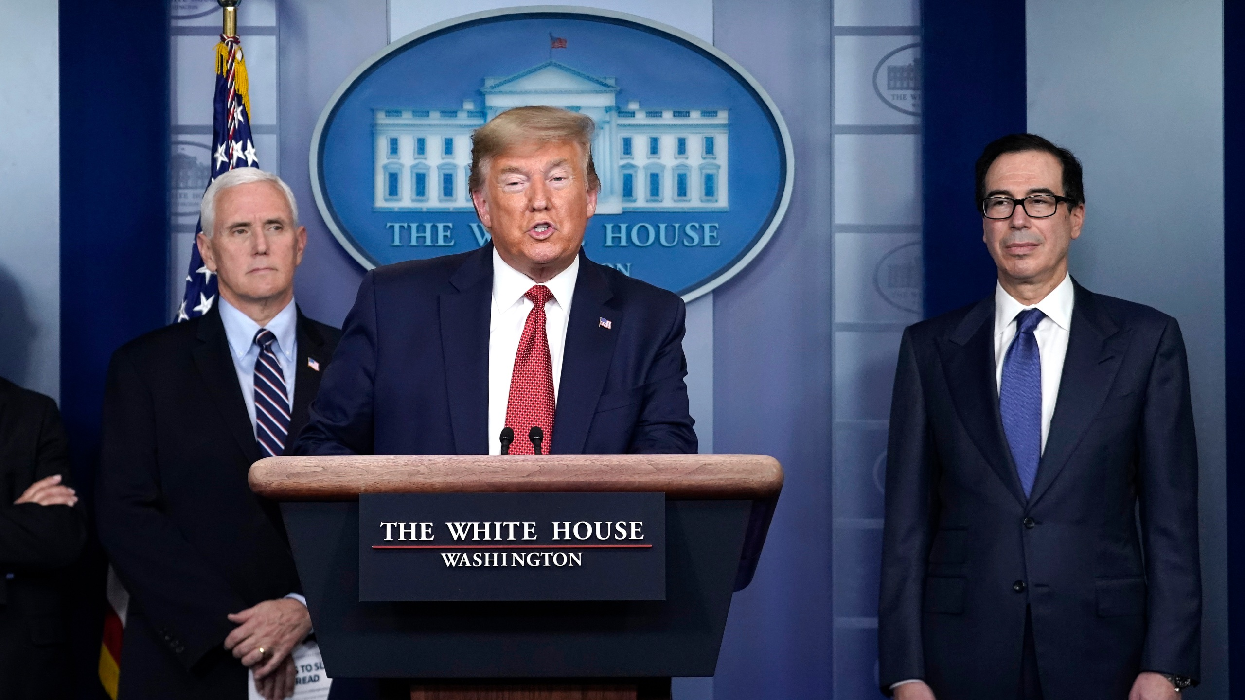 U.S. President Donald Trump, joined by members of the Coronavirus Task Force, Vice President Mike Pence and Secretary of the Treasury Steven Mnuchin, speaks during a briefing on the coronavirus pandemic, in the press briefing room of the White House on March 25, 2020. (Drew Angerer/Getty Images)