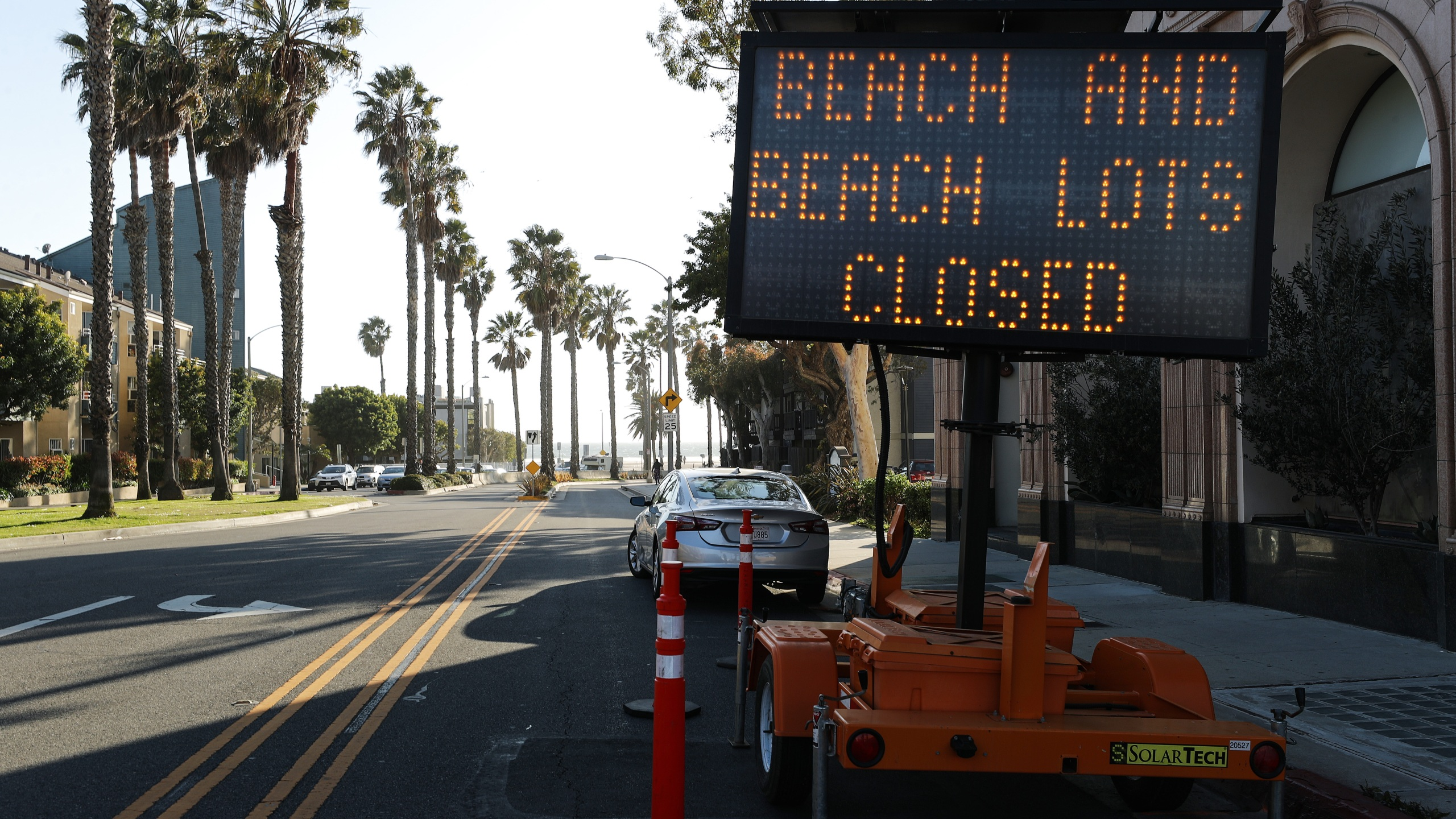 A road sign announces closures at Santa Monica beach amid the coronavirus pandemic on March 27, 2020 in Santa Monica. (Mario Tama/Getty Images)