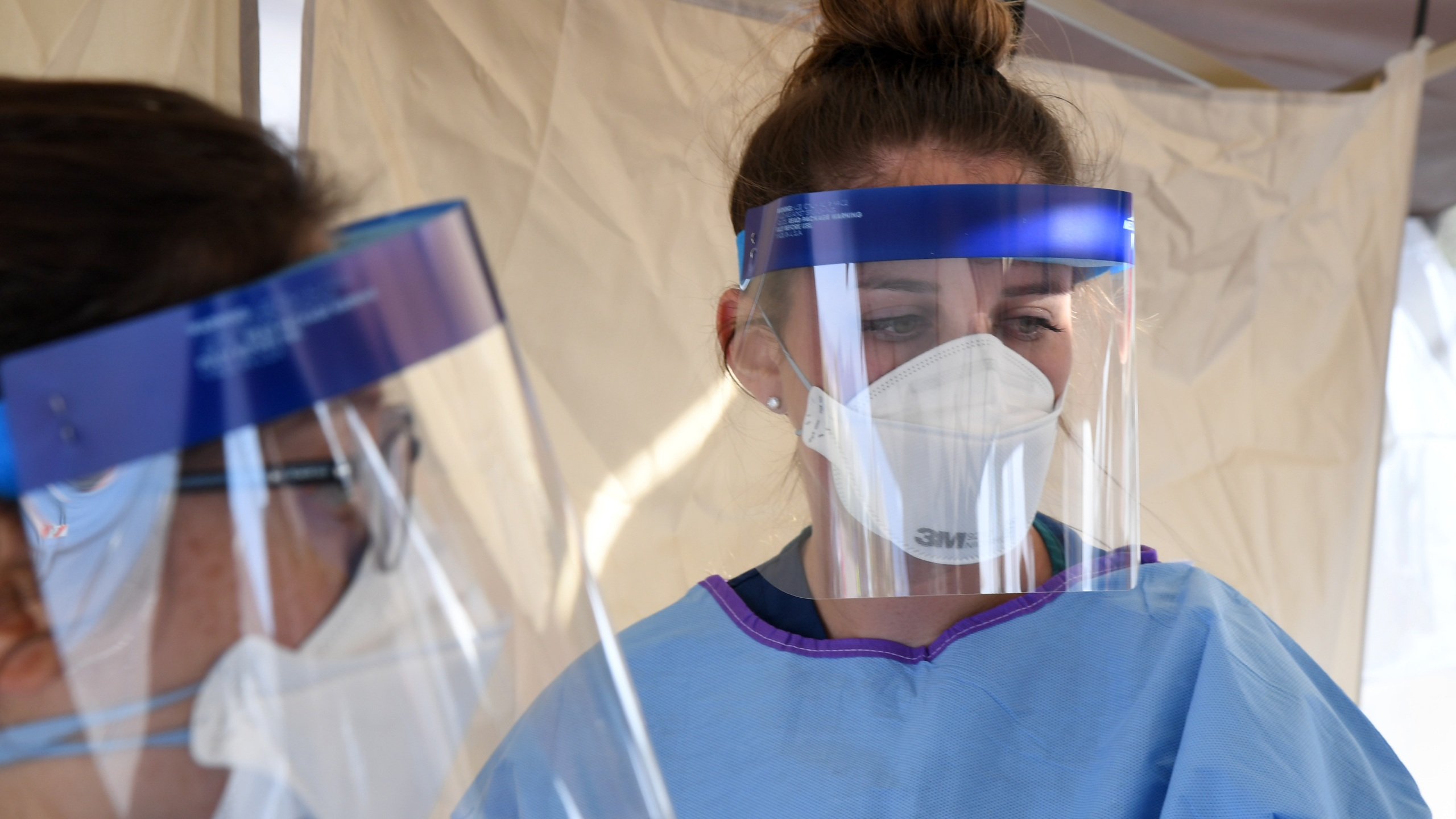 Touro University Nevada medical student Allison Boynton waits to conduct medical screenings at a temporary homeless shelter set up in a parking lot at Cashman Center on March 28, 2020, in Las Vegas, Nevada. (Ethan Miller/Getty Images)