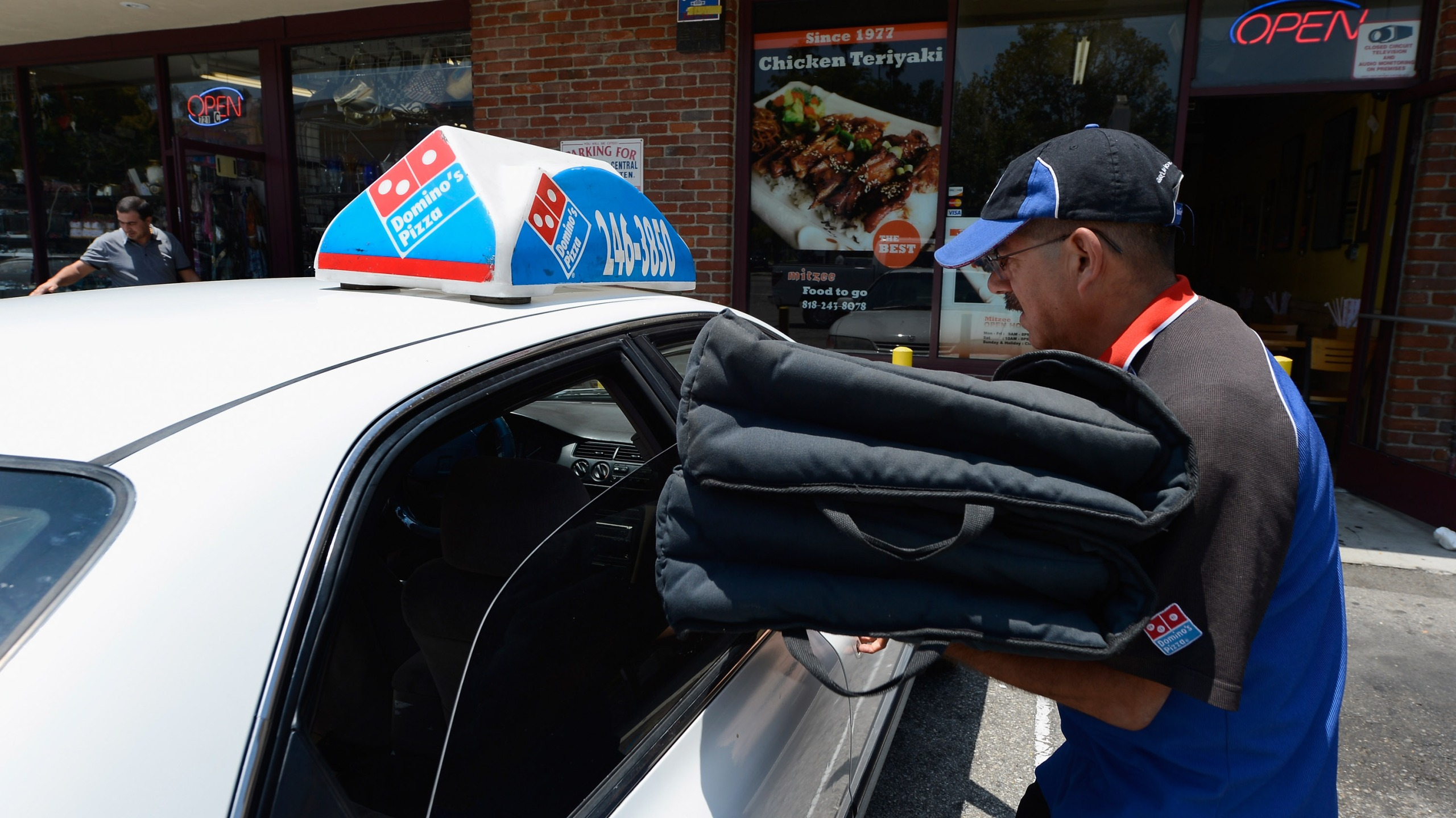 A Domino's Pizza delivery man sets out for delivery on June 21, 2012 in Glendale, California. (Kevork Djansezian/Getty Images)
