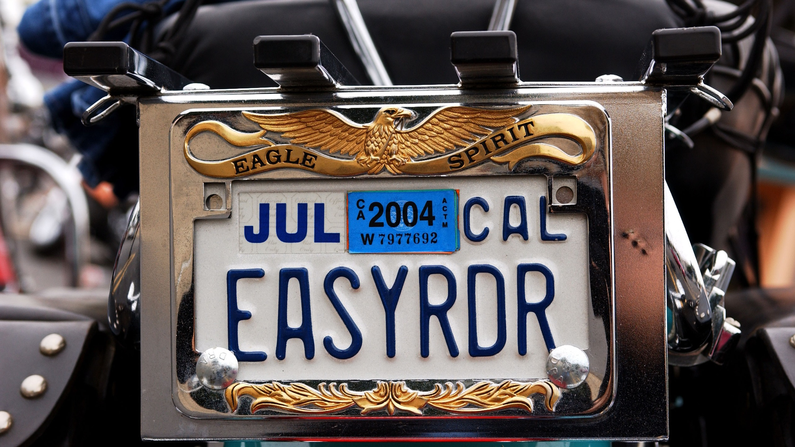 A vanity license plate sits on a Harley-Davidson motorcycle in Glendale on Nov. 9, 2003. (Credit: Amanda Edwards / Getty Images)