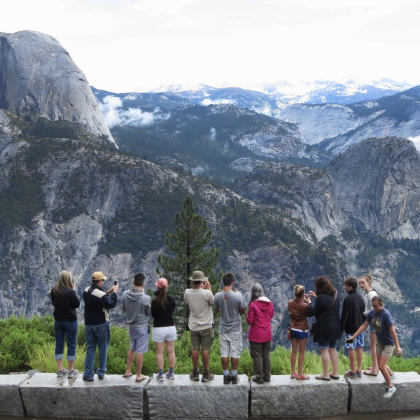 Visitors look out at Yosemite National Park from Glacier Point on July 21, 2014 in Yosemite National Park. (Sean Gallup/Getty Images)