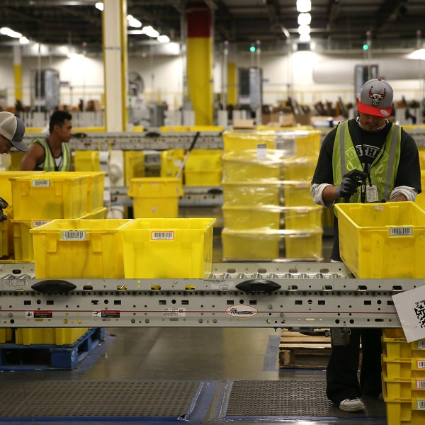 Amazon.com workers pack orders at an Amazon fulfillment center on Jan. 20, 2015 in Tracy, California. (Justin Sullivan/Getty Images)