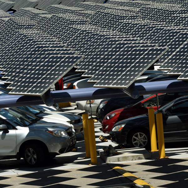 Solar panels used to generate power outside an office building in Los Angeles on Aug. 4, 2015. (MARK RALSTON/AFP via Getty Images)