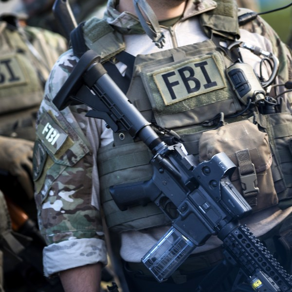 Members of a Federal Bureau of Investigation SWAT team are seen during an FBI field training exercise at the Landmark Mall on May 2, 2014, in Virginia. (BRENDAN SMIALOWSKI/AFP via Getty Images)