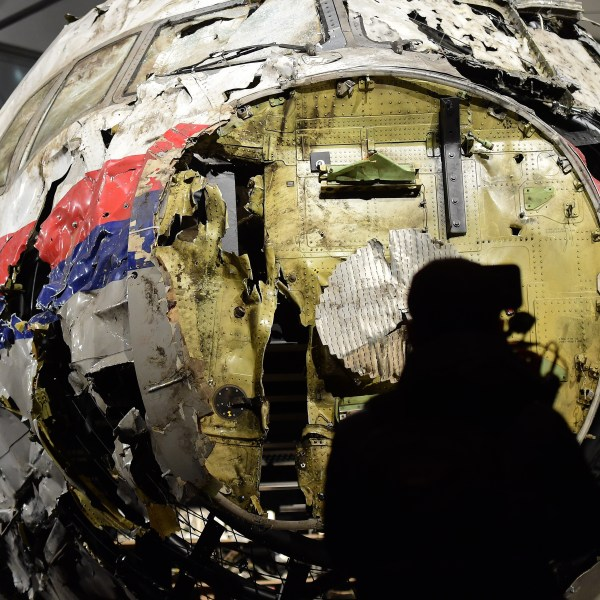 The wrecked cockpit of the Malaysia Airlines flight MH17 is presented to the press during a presentation of the final report on the cause of the its crash at the Gilze Rijen airbase October 13, 2015. (EMMANUEL DUNAND/AFP via Getty Images)