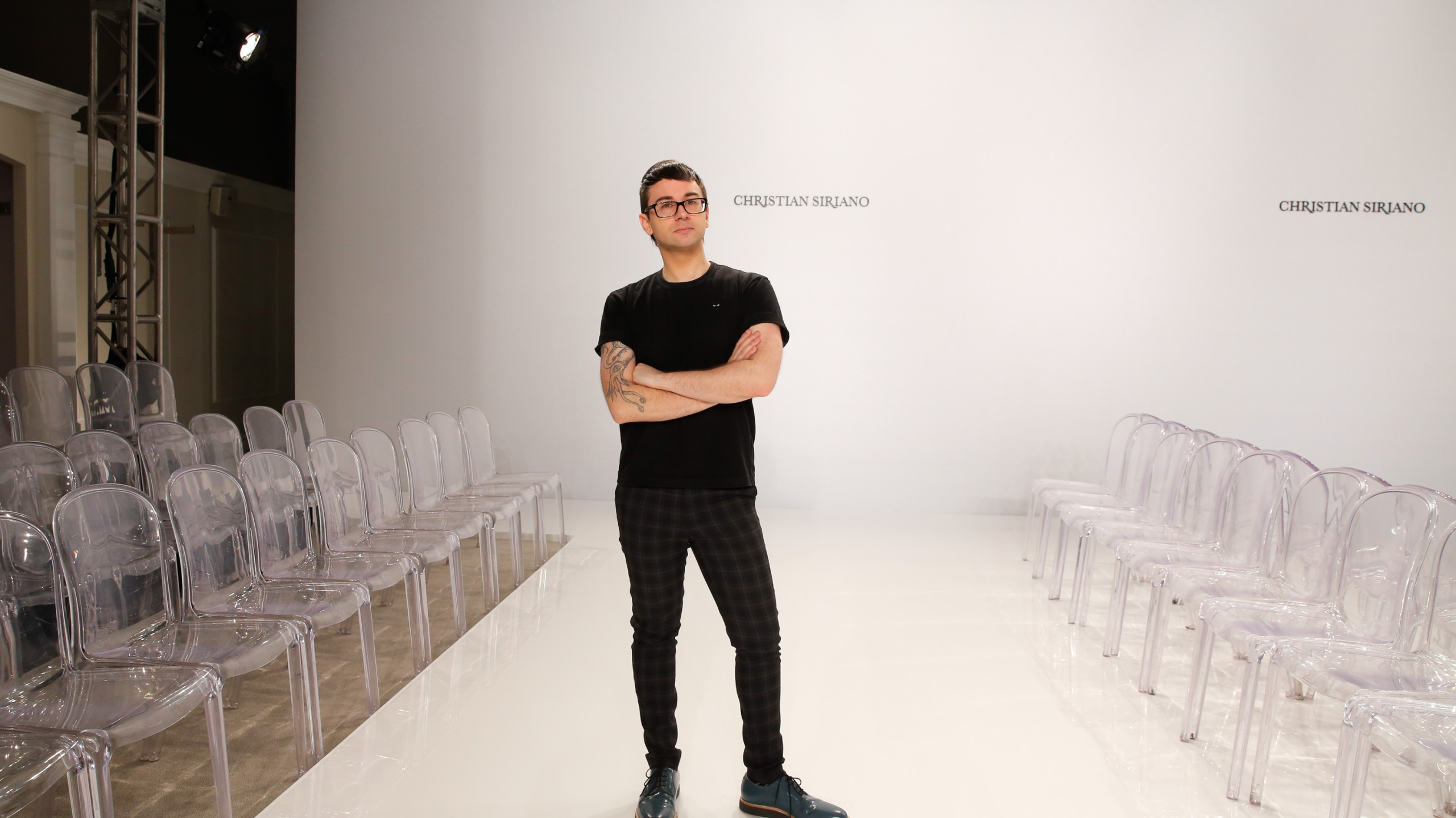 Designer Christian Siriano poses on the runway before his Christian Siriano For Kleinfeld Spring/Summer 2017 Bridal Collection at Kleinfeld on April 18, 2016 in New York City. (JP Yim/Getty Images)