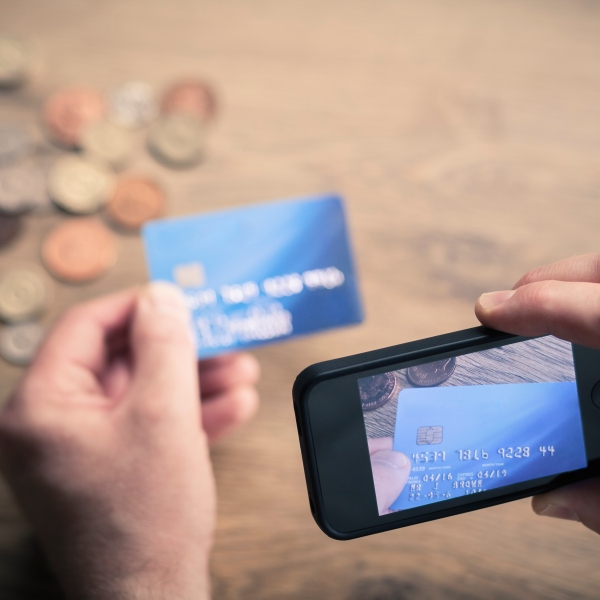 A man photographs a credit card in this undated file photo. (Getty Images)