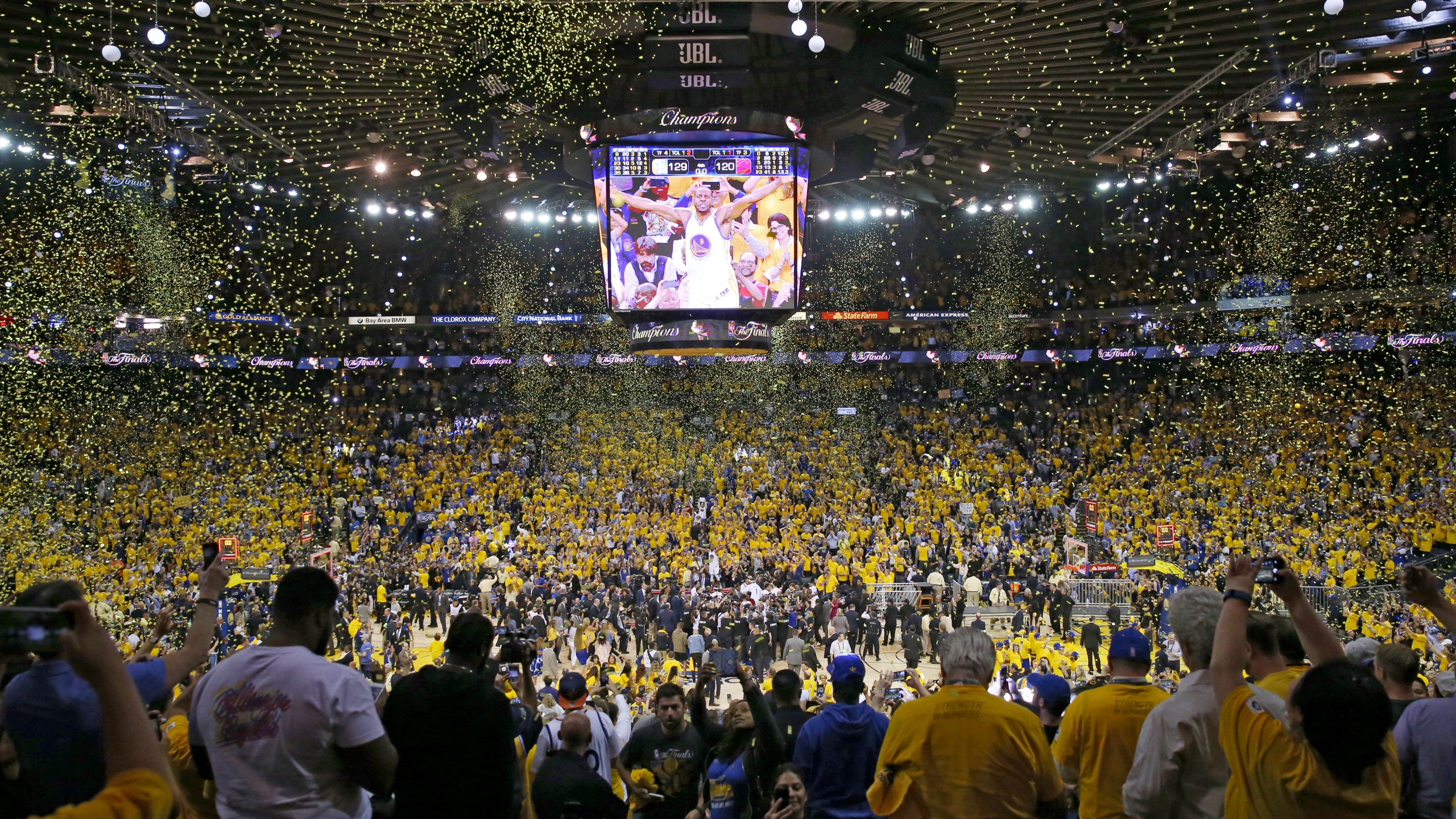 Fans cheer as the Golden State Warriors celebrate after defeating the Cleveland Cavaliers 129-120 in Game 5 to win the 2017 NBA Finals at ORACLE Arena on June 12, 2017, in Oakland, California. ( Ezra Shaw/Getty Images)