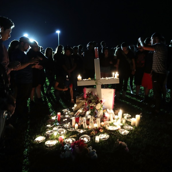 Students, friends and family gather for a candlelight vigil for victims a day after the mass shooting at Marjory Stoneman Douglas High School in Parkland, Florida, on Feb. 15, 2018. (Credit: Mark Wilson / Getty Images)
