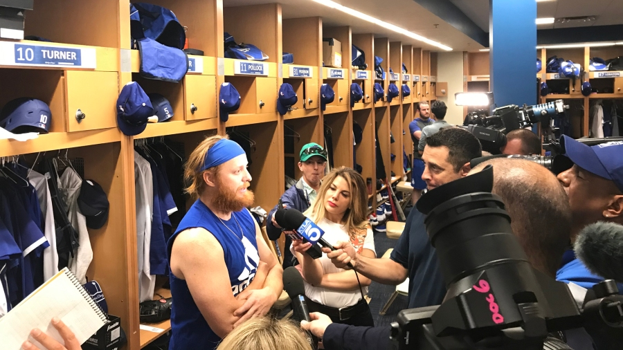 Dodgers player Justin Turner is interviewed by reporters during Spring Training at Camelback Ranch in , Phoenix, Arizona on Feb. 18, 2020. (Ismael Loya/KTLA)