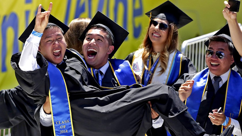 UC Irvine graduates celebrate in 2014. The school has canceled its traditional commencement ceremonies for the first time in its 55-year history.(Irfan Khan/Los Angeles Times)