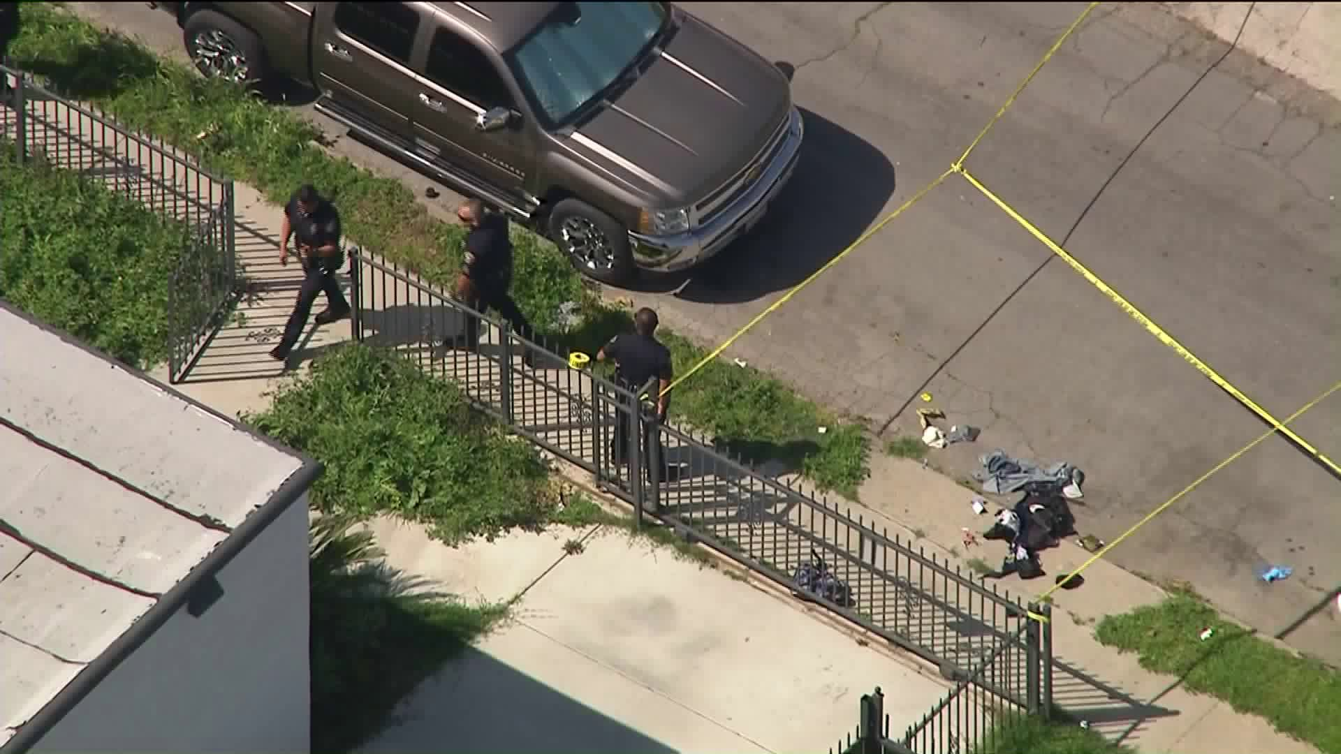 Long Beach Police Department officers work at the scene of an officer-involved shooting on March 30, 2020. (KTLA)