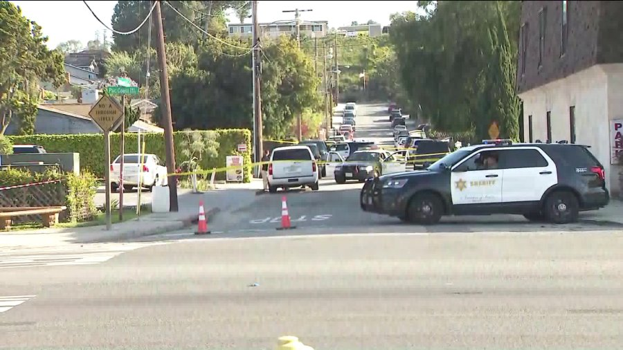 Sheriff's deputies investigate the scene of a shooting that left two boys and a man dead in Lomita on March 29, 2020. (KTLA)