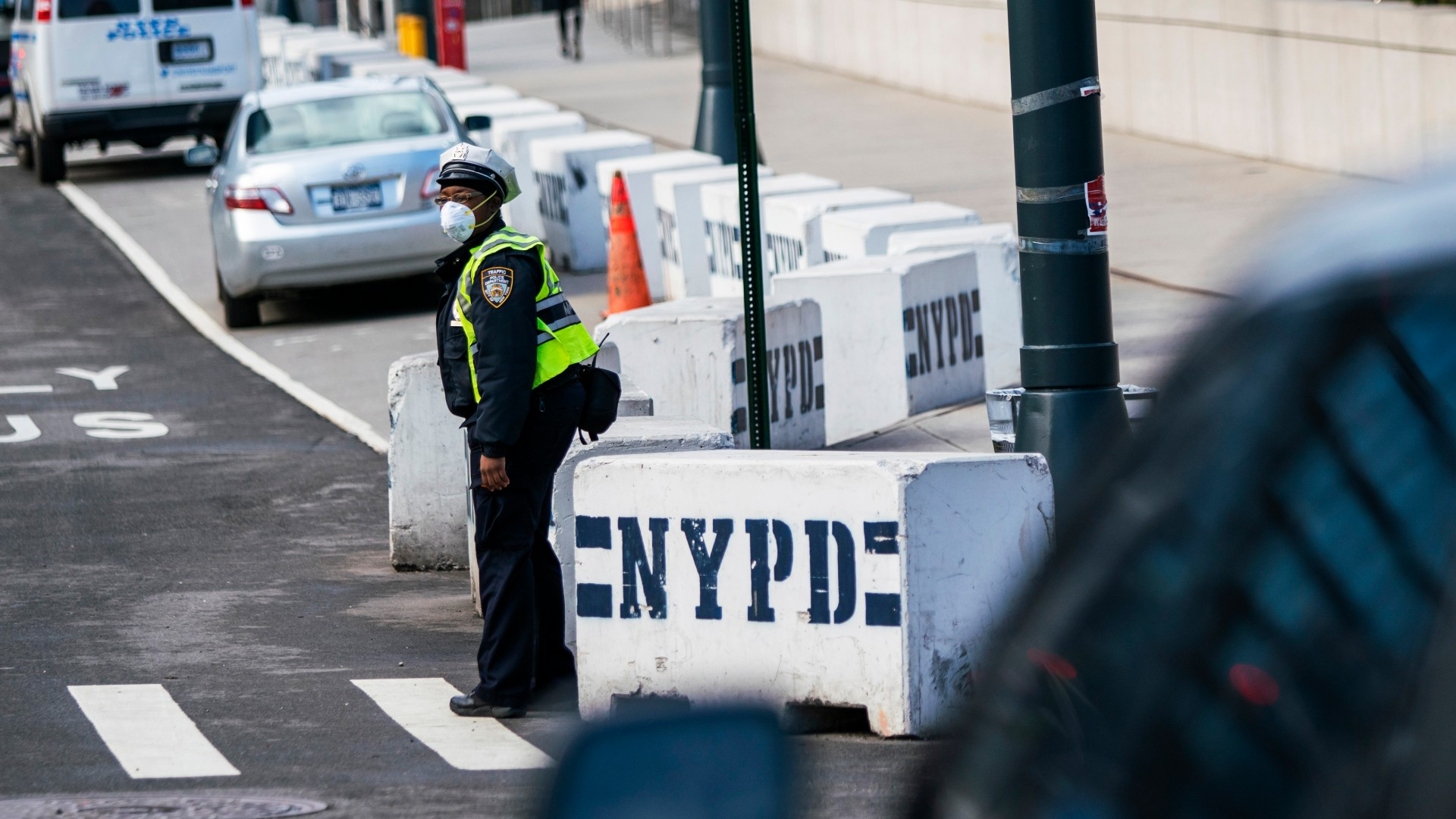 A New York Police officer wears a face mask as he directs traffic on a local street on March 27, 2020, in New York City. (Eduardo Munoz Alvarez/Getty Images)