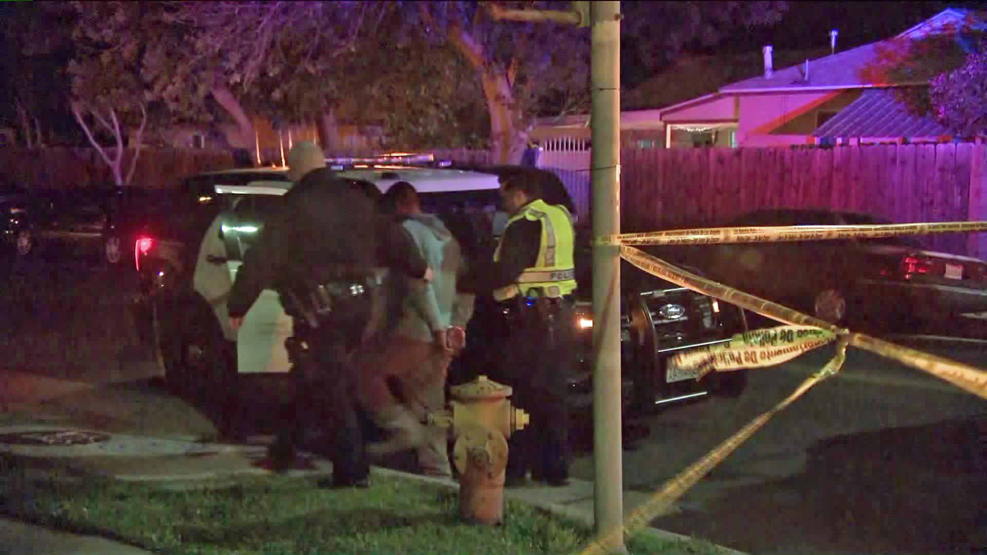 Police take a man into custody in connection with an alleged DUI, hit-and-run crash that left a woman dead in Reseda on March 2, 2020. (Credit: KTLA)