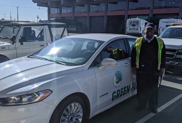 A Torrance employee stands next to a city vehicle in this photo released by the city to promote a grocery delivery service for at-risk community members set to begin on March 31, 2020.