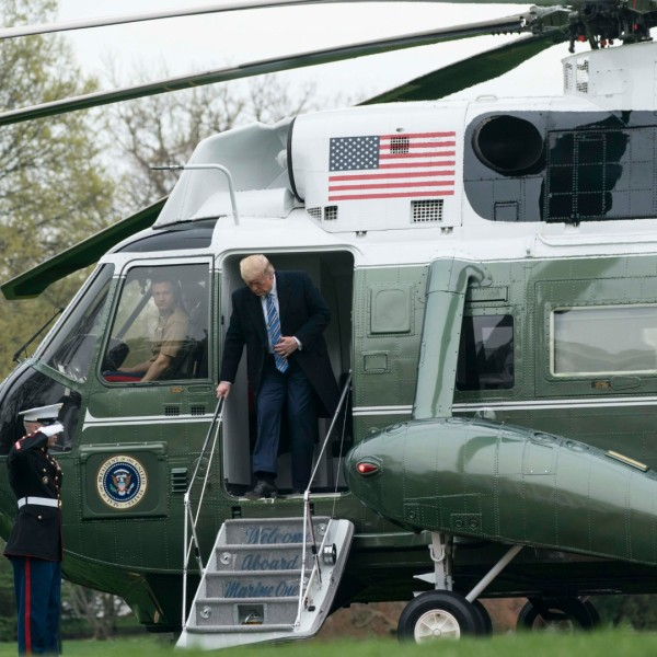 U.S. President Donald Trump departs Marine One as he arrives to the White House on March 28, 2020 in Washington, DC. President Trump traveled to Norfolk, Virginia to attend a departure ceremony for the U.S. Navy hospital ship USNS Comfort, which is sailing to New York City to aid in the coronavirus outbreak. (Sarah Silbiger/Getty Images)