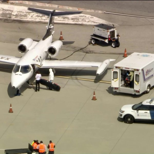 An air ambulance apparently carrying a man who was diagnosed with the new coronavirus is seen on March 19, 2020. (KTLA)
