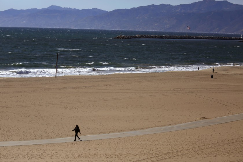 A beach in the Los Angeles area is empty in March 2020 as local officials established restrictions to stem the spread of COVID-19, closing businesses and shutting down trails and beaches throughout L.A. County. (Genaro Molina/Los Angeles Times)