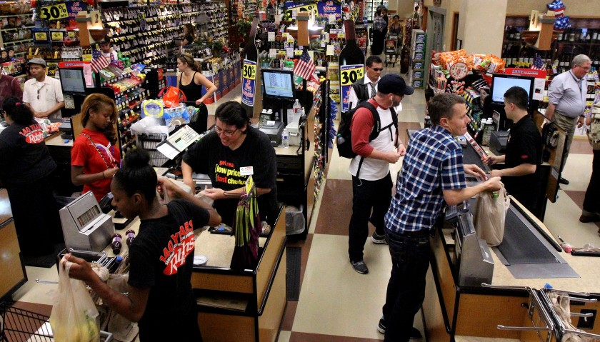 Customers shop at a grocery store in Los Angeles. (Cheryl A. Guerrero / Los Angeles Times)