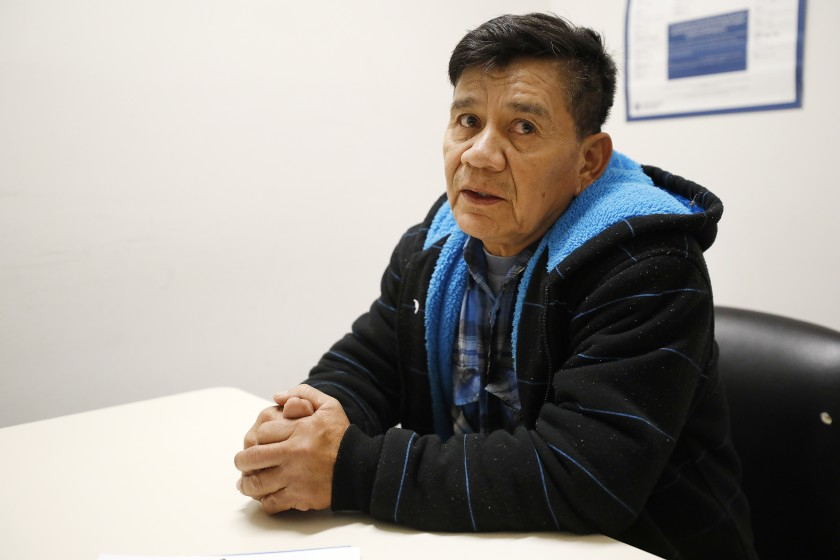 Pedro Bravo Castillo, 58, sits at a table at the Enforcement and Removal Operations processing center in downtown L.A. On March 27, 2020, a federal judge ordered that he and another immigrant be released from the Adelanto Detention Facility over COVID-19 concerns. (Al Seib / Los Angeles Times)