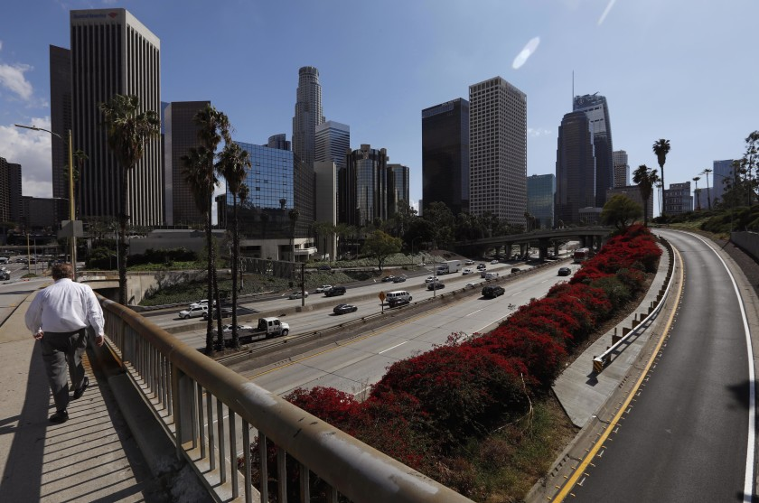 The 110 Freeway through downtown had noticeably lighter traffic on the afternoon of March 11, 2020.(Genaro Molina / Los Angeles Times)