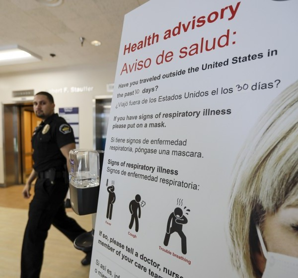 In February 2020, a coronavirus health advisory appears in the emergency department at St. Joseph Medical Center in Orange. (Irfan Khan / Los Angeles Times)