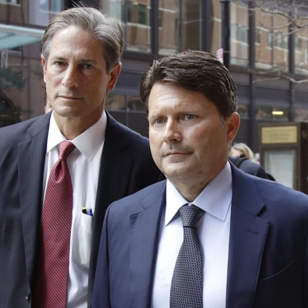 Devin Sloane, right, arrives at federal court in Boston for his sentencing last year. Citing the COVID-19 pandemic, Sloane asked a judge, unsuccessfully, to release him from prison early. (Elise Amendola/Associated Press)