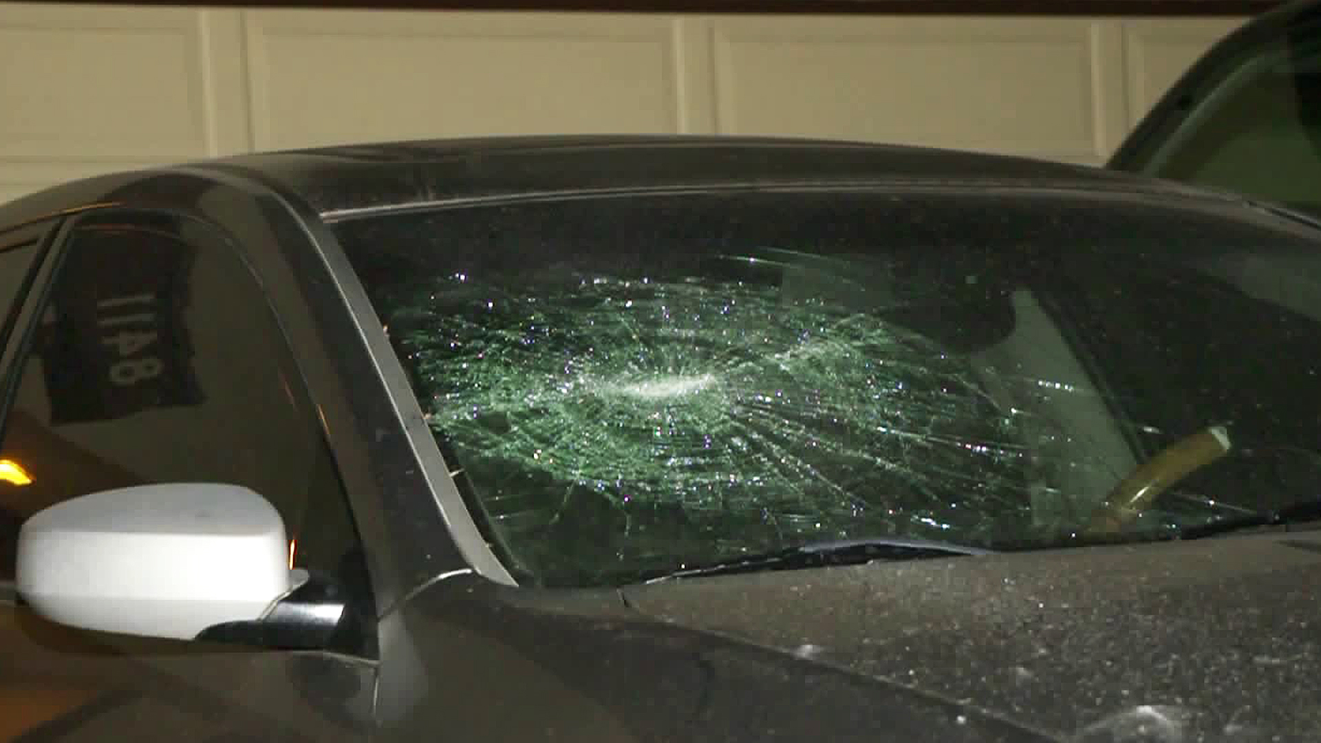 A car is seen with a smashed windshield in Canoga Park on March 6, 2020. (RMG News)