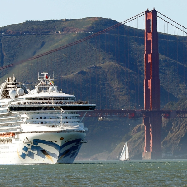 In this Feb. 11, 2020 photo, the Grand Princess cruise ship passes the Golden Gate Bridge as it arrives from Hawaii in San Francisco. California's first coronavirus fatality is an elderly patient who apparently contracted the illness on a cruise, authorities said Wednesday, March 4, and a medical screener at Los Angeles International Airport is one of six new confirmed cases. The cruise ship is at sea but is expected to skip its next port and return to San Francisco by Thursday, according to a statement from Dr. Grant Tarling, the chief medical officer for the Carnival Corp., which operates the Grand Princess. Any current passengers who were also on the February trip will be screened. (Scott Strazzante/San Francisco Chronicle via AP)