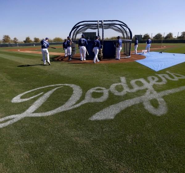 Members of the Dodgers take batting practice at spring training in Arizona.(Gary Coronado / Los Angeles Times)
