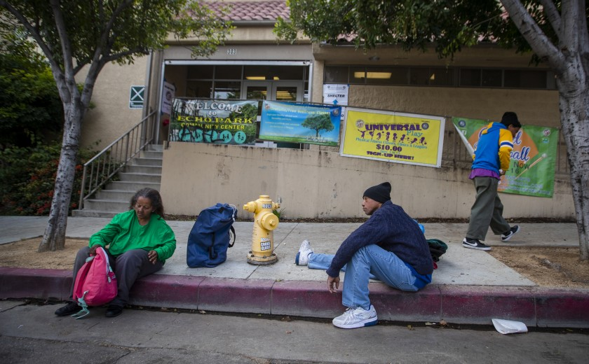 A 53-year-old man waits with other homeless people on March 20, 2020, at the Echo Park Community Center, which is being turned into a shelter because of the coronavirus pandemic. (Allen J. Schaben/Los Angeles Times)