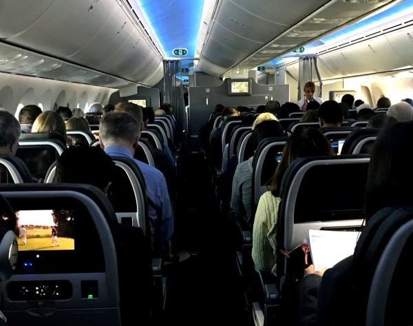 Airline passengers on a recent flight.(Jerome Adamstein / Los Angeles Times)