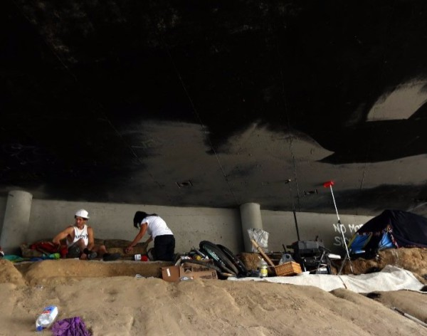 A homeless encampment beneath the 110 Freeway in Harbor City is seen in this undated photo. (Credit: Genaro Molina / Los Angeles Times)
