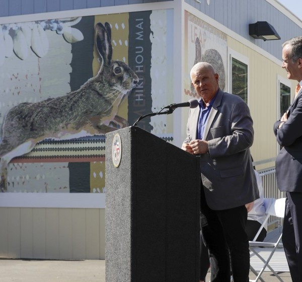 L.A. City Councilman Mike Bonin, left, and Mayor Eric Garcetti at the grand opening of Pacific Sunset, a 154-bed bridge home shelter in Venice.(Credit: Irfan Khan / Los Angeles Times)