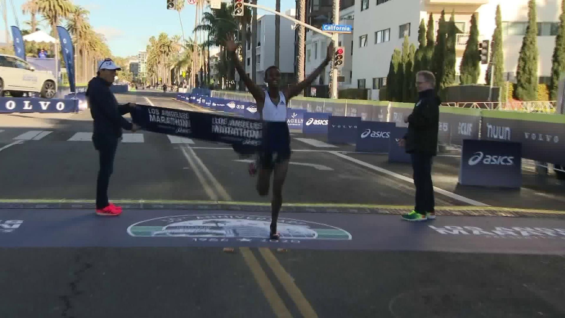 Bayelign Teshager cross the L.A. Marathon finish line on March 8, 2020. (KTLA)