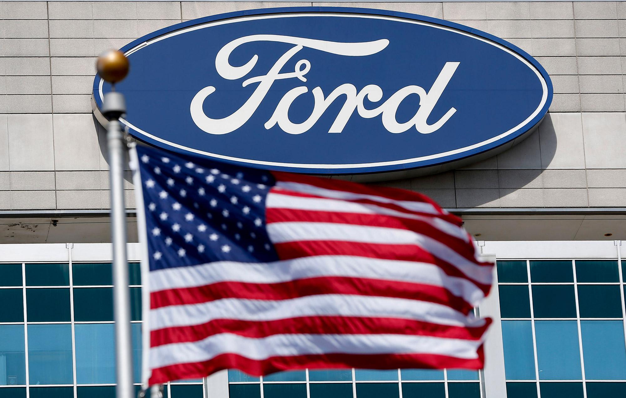 A U.S. flag flies at the Ford Motor Co. headquarters in Dearborn, Michigan, on March 18, 2015. (Jeff Kowalsky/Bloomberg via Getty Images)