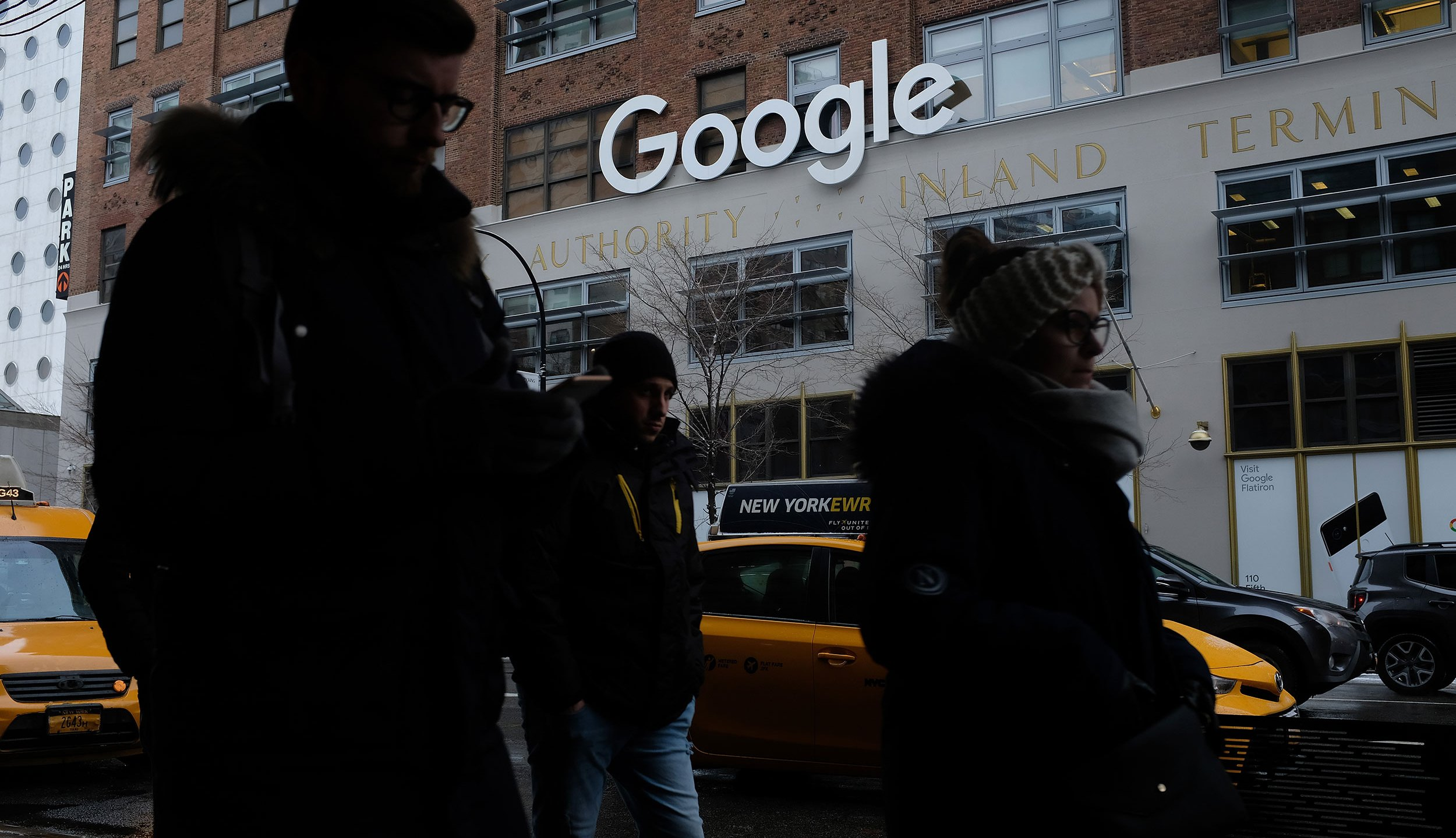 People walk past a Google office building on 9th Avenue in Chelsea district on Dec. 30, 2017, in New York City. ( Sean Gallup/Getty Images)