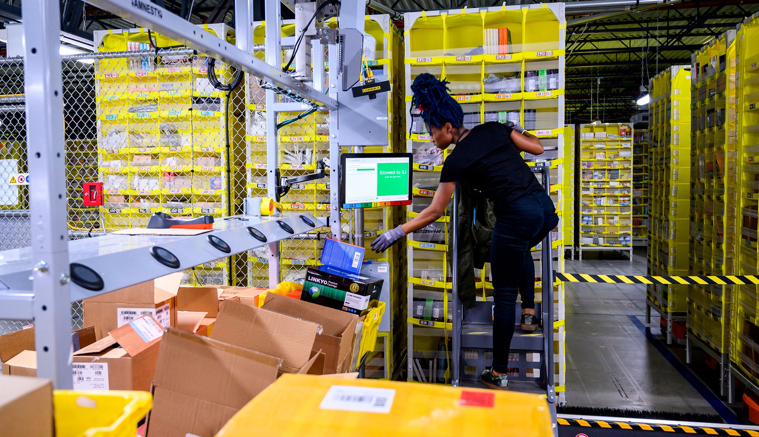 Amazon employees at the company's Staten Island, New York, facility plan to walk off the job Monday amid allegations the online retail giant has mishandled its response to the coronavirus pandemic. (Johannes Eisele/AFP/Getty Images)