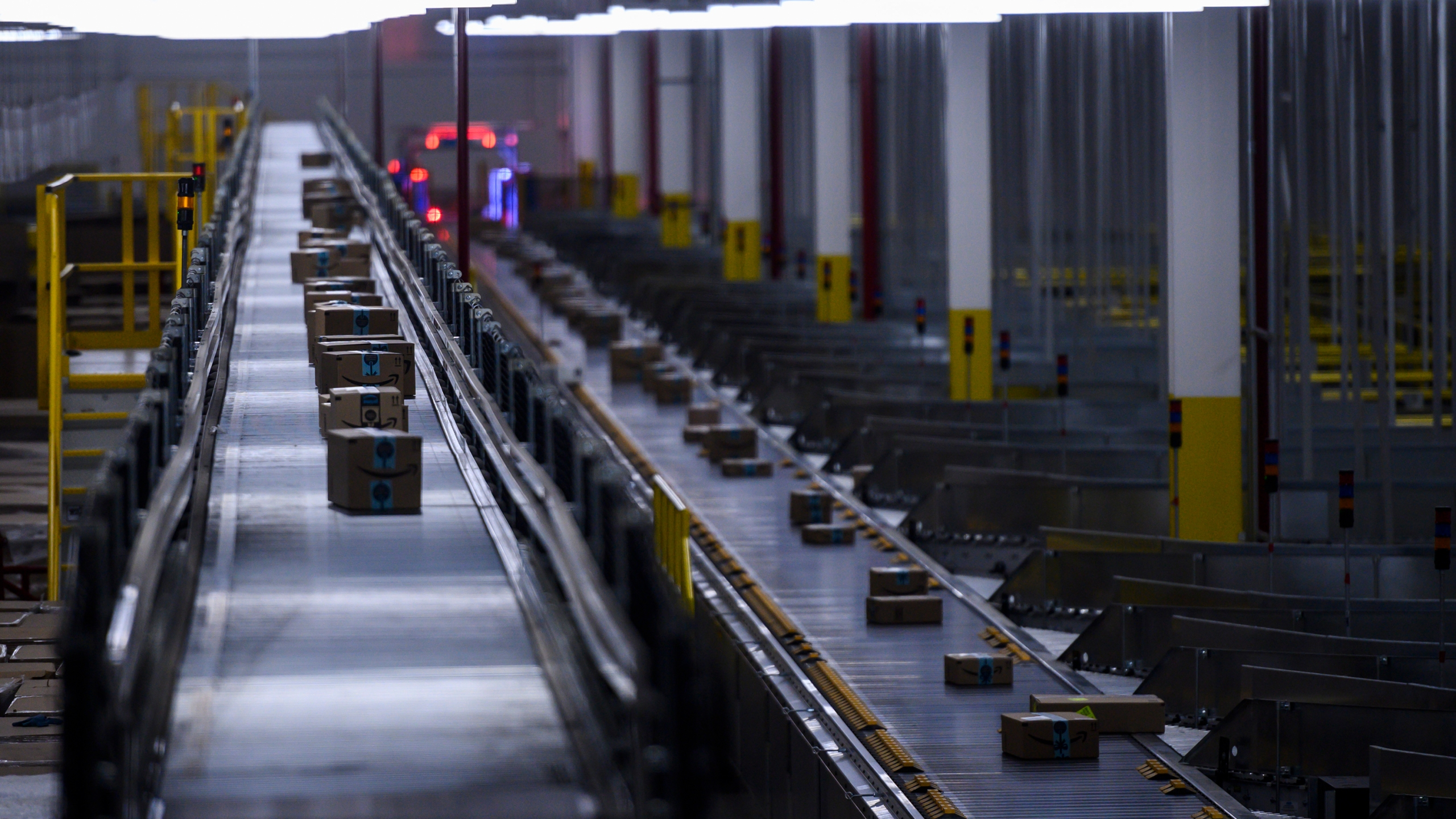 Orders move down a conveyor belt at the 855,000-square-foot Amazon fulfillment center in Staten Island, one of the five boroughs of New York City, on Feb. 5, 2019. (Johannes Eisele/AFP via Getty Images)