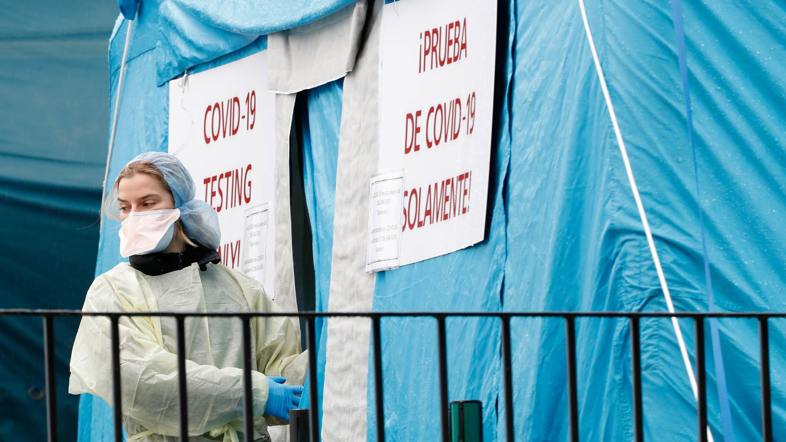 A medical worker prepares to reenter a COVID-19 testing tent set up outside Elmhurst Hospital Center in New York, Saturday, March 28, 2020. (Kathy Willens/AP)