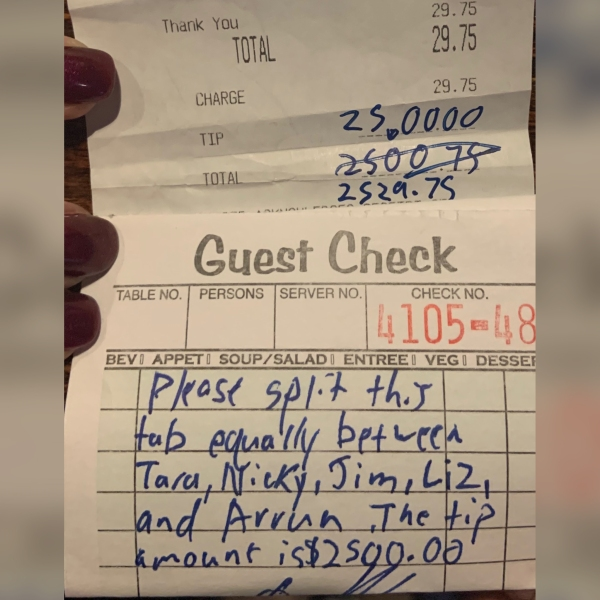 """After ordering a beer and some food, the customer's check came out to be just under $30. But after he left, the spirits of owner Patrick """"Benny"""" Leonard and his staff were uplifted immediately after seeing the tip he had left. (CNN)"""