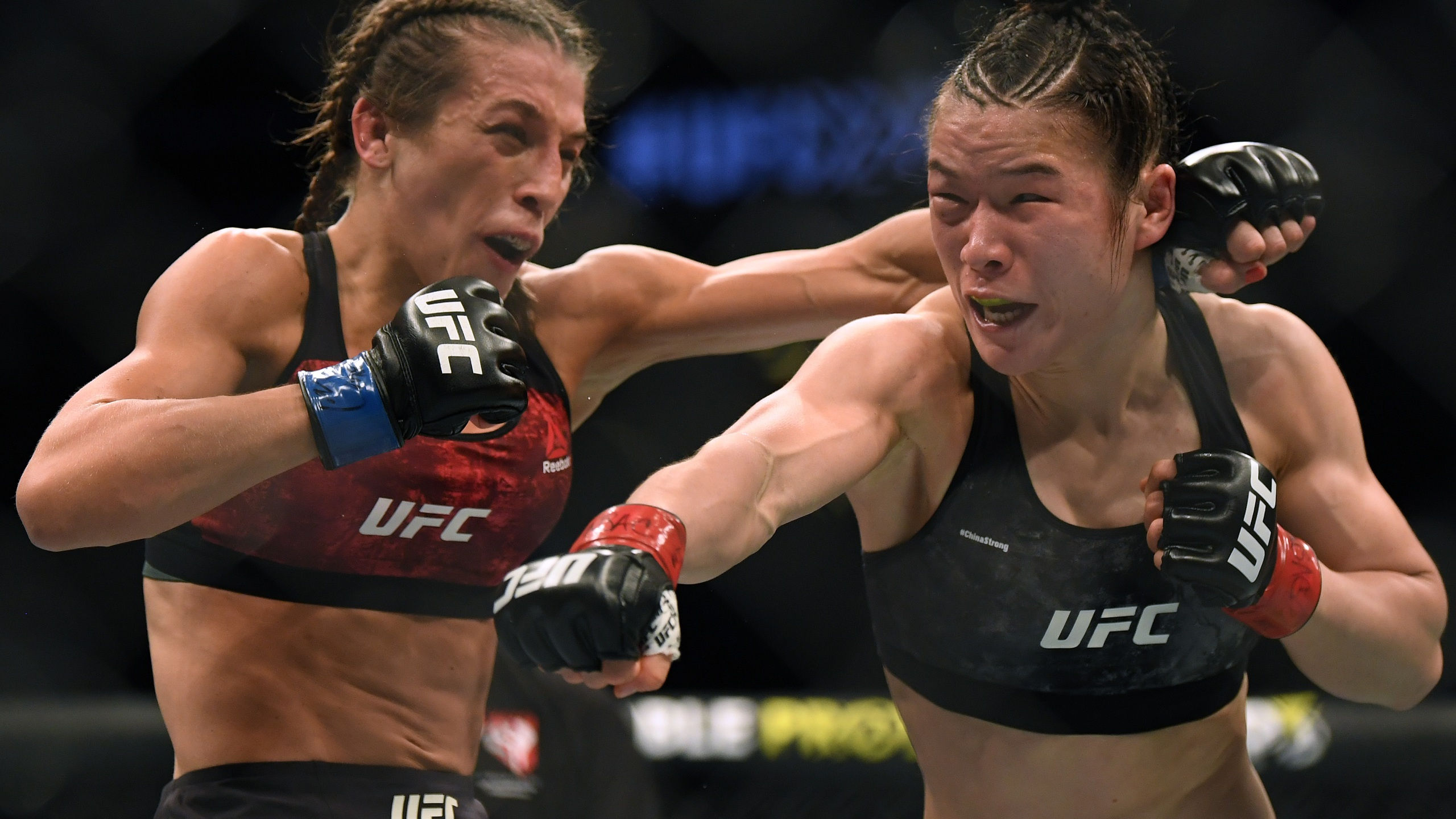 Weili Zhang punches Joanna Jedrzejczyk during UFC 248, the last UFC event to take place in front of fans. (Harry How/Getty Images North America/Getty Images)