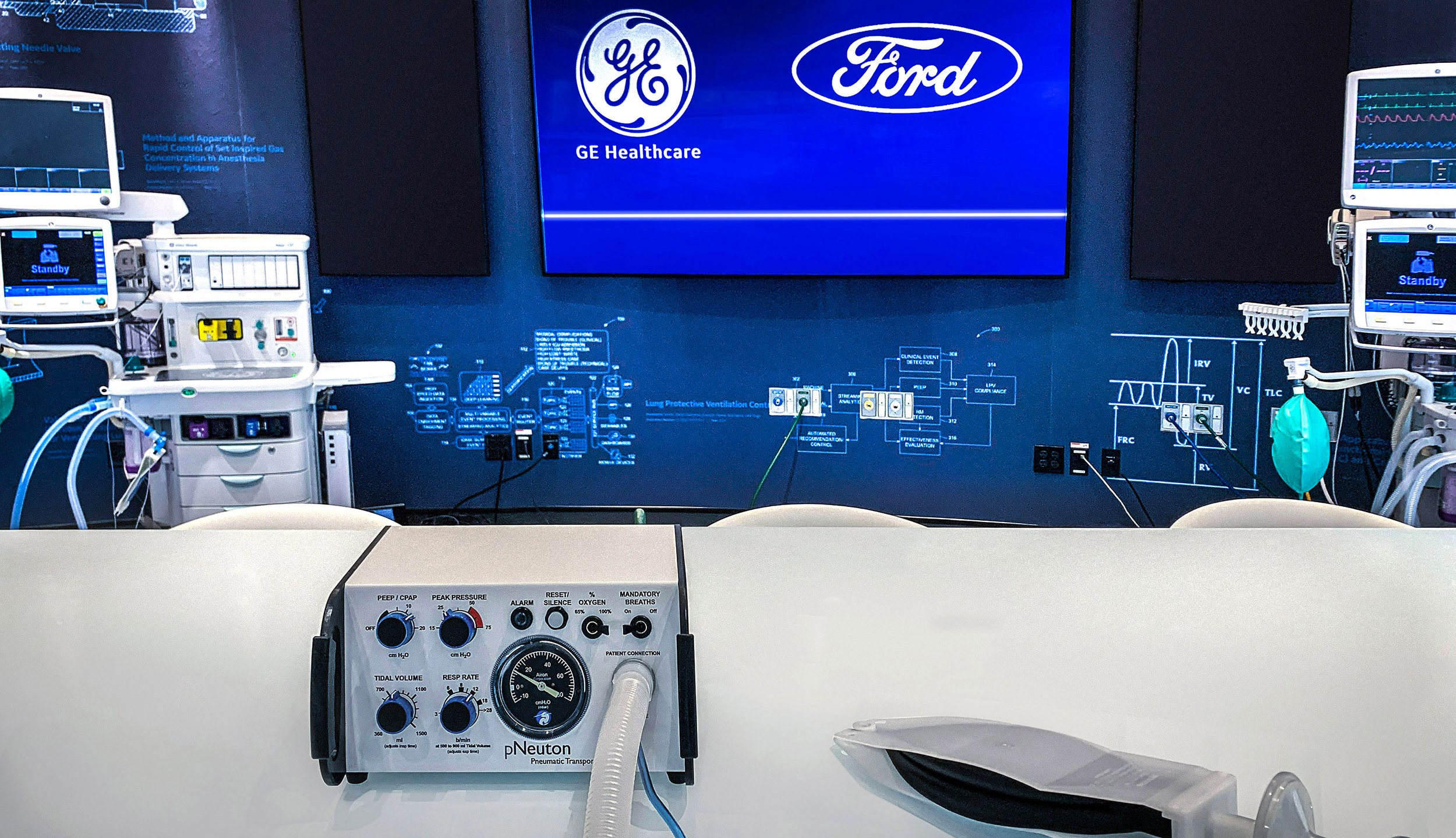A Model A-E ventilator, left, and a simple test lung. The ventilator uses a design that operates on air pressure without the need for electricity, addressing the needs of most COVID-19 patients. Its production can be quickly scaled to help meet growing demand in the U.S. (Ford Motor Company)