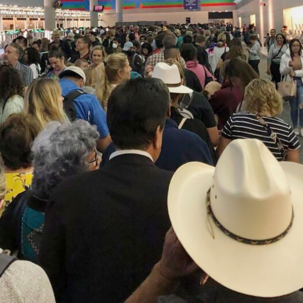 People wait in line to go through the customs at Dallas Fort Worth International Airport in Grapevine, Texas, on March 14, 2020. (Austin Boschen via AP via CNN)