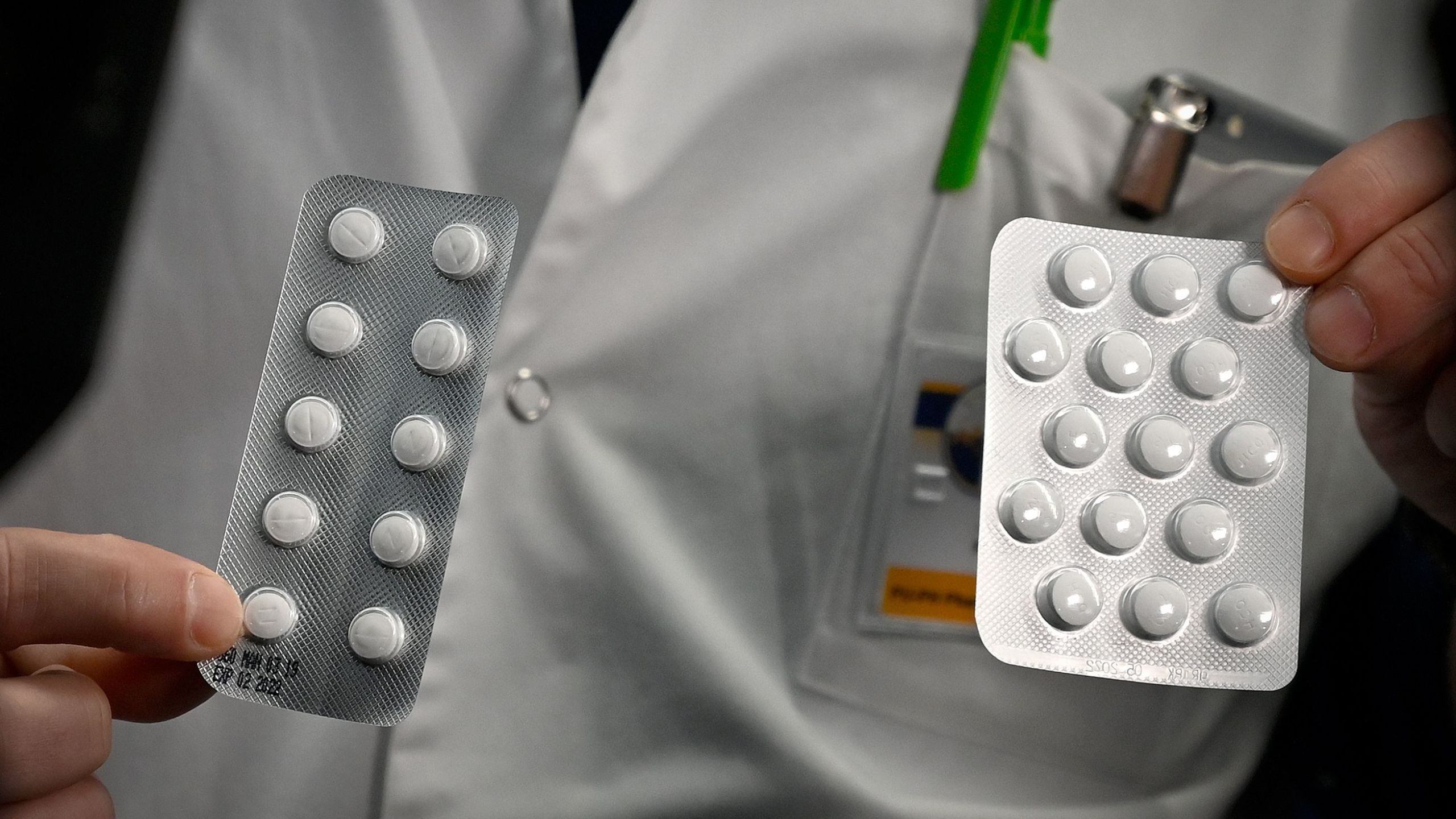 Medical staff shows on February 26, 2020 at the IHU Mediterranee Infection Institute in Marseille, packets of a Nivaquine, tablets containing chloroquine and Plaqueril, tablets containing hydroxychloroquine, drugs that has shown signs of effectiveness against coronavirus. (GERARD JULIEN/AFP via Getty Images)