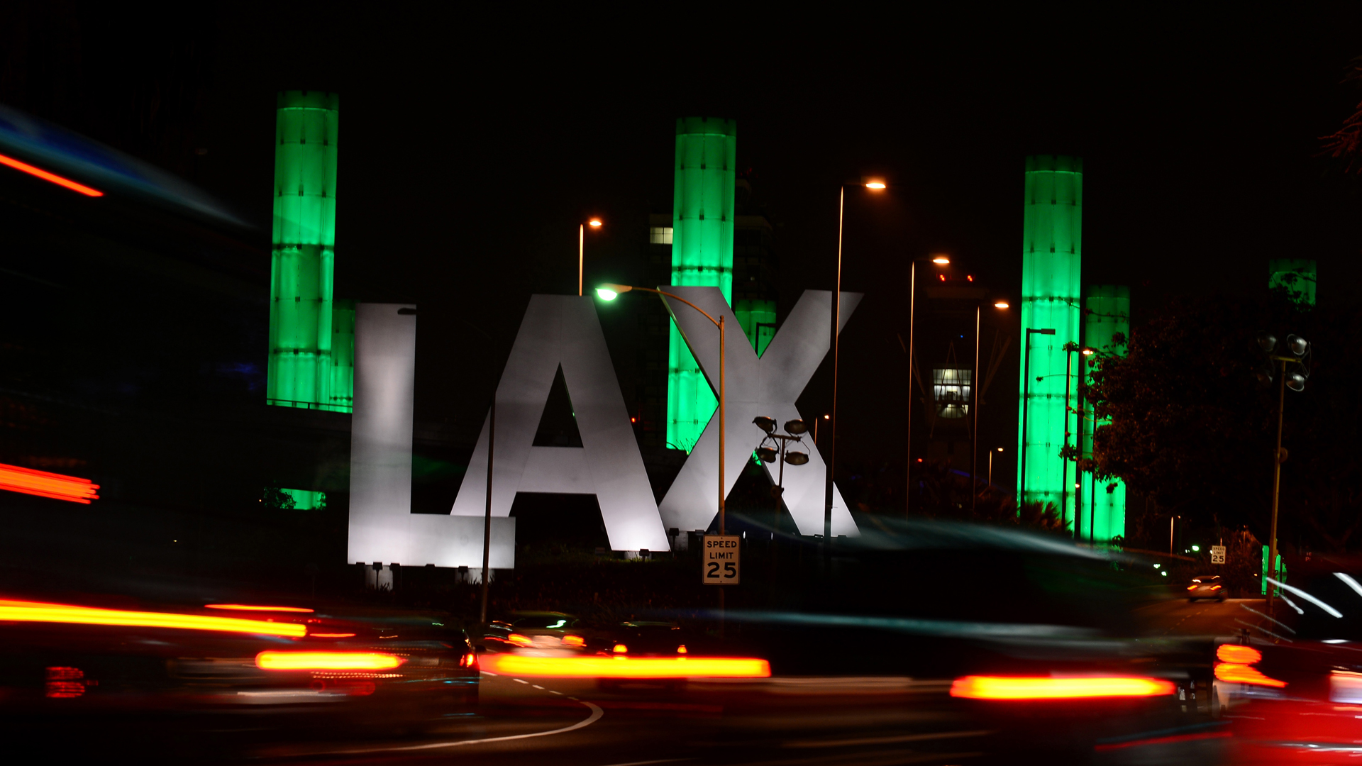 The 100-foot LAX Gateway pylons at Los Angeles International Airport are lit green on March 23, 2013. (FREDERIC J. BROWN/AFP via Getty Images)