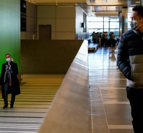 People walk up the ramp, exiting the secure area at the Tom Bradley International Terminal at LAX in this undated photo. (Kent Nishimura/Los Angeles Times)